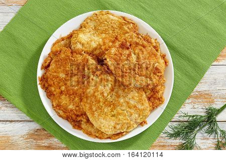 Pan Fried Pork Chops On White Dish On Table Mat