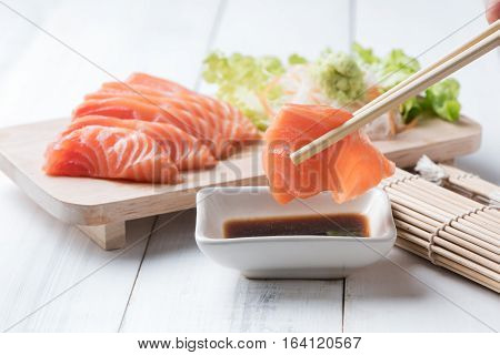 Salmon Sashimi  With Chopsticks.