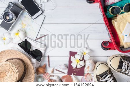 Prepare Accessories And Travel Items On White Wooden