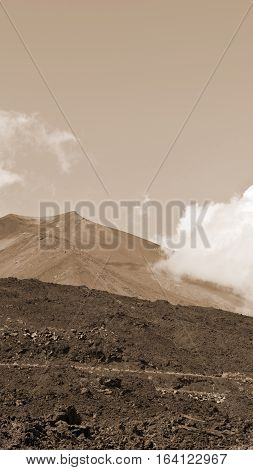 Congealed Black Lava on the Slopes of Mount Etna in Sicily Vintage Style Sepia