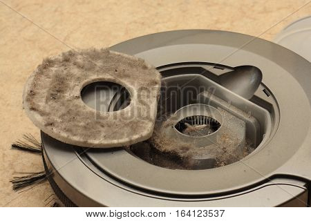 Robotic vacuum cleaner with trays full of dust and clutter