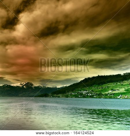 Lake Sarner on the Background of Snow-capped Alps in Switzerland at Sunset Vintage Style Toned Picture