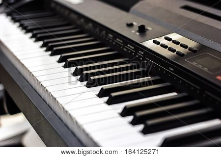 Piano close up black and white Piano keyboard background with selective focus, studio music synthesizer keyboard side view of instrument musical tool