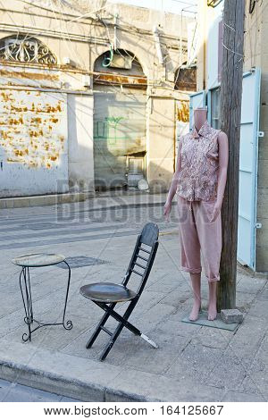 Female shop dummy fashion mannequin near the department store boutique wearing current women's fashions in clothes. City of Jaffa in Israel