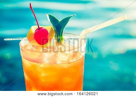 Fruit cocktail in a glass glass pool