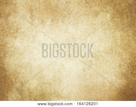Aged yellowed paper background. Rustic paper texture for the design.