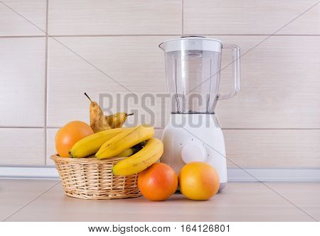 Blender With Fruits On Kitchen Countertop
