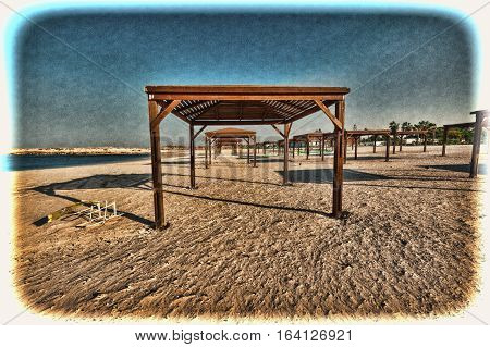 Sunshade on the Beach of Mediterranean Sea in Israel. Vintage Style Toned Picture