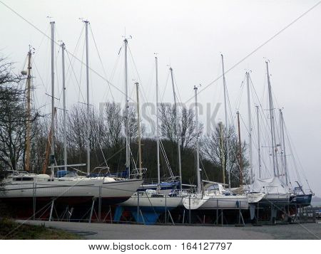 Sail boats laid up by Flensburg Fjord on cold winters day