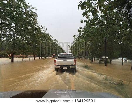 PATTALUNG, THAILAND, JAN 4, 2017: Water flooding on the street in Thailand