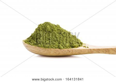 powdered green tea with bamboo spoon on white background