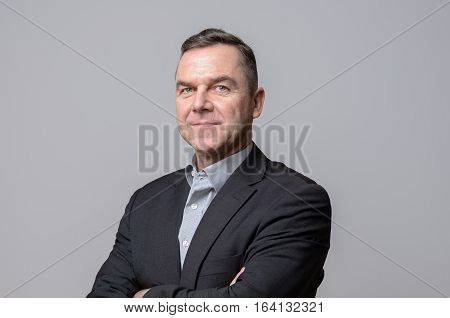 Confident Middle Age Businessman Over Gray
