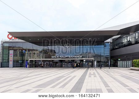 VIENNA, AUSTRIA - MAY 18, 2016: Facade of the main railway station of wien with OBB logo company and people