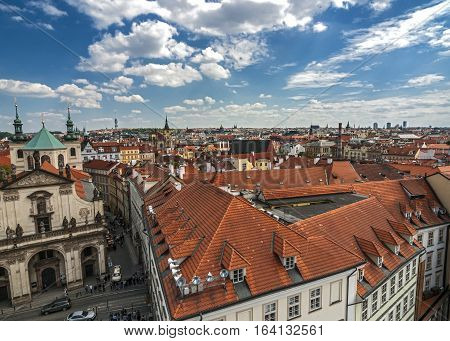 View of the streets and rooftops of area Stare Mesto Prague from the tower of the Charles Bridge. Church of St. Salvator.