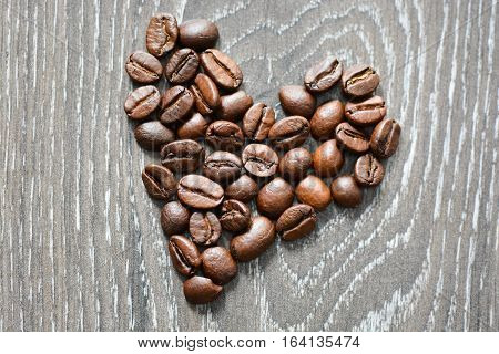 Heart shaped coffee beans suggesting coffee addiction