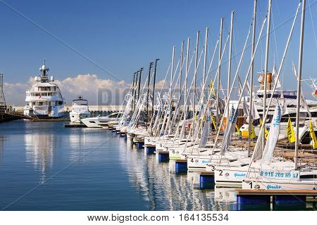 Sochi Russia - November 1 2015: Sailing yachts and private boats moored at pier in Sochi seaport. Grand Marina station complex Port. Krasnodarskiy kray Russia