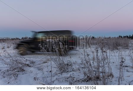 The river Tosno, Leningrad region, Russia - January 03, 2017 Jeep Wrangler unlimited off-road, Wrangler is a compact SUV produced by Chrysler