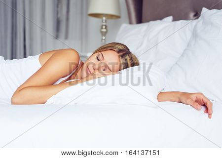 Beautiful Woman Sleeps In The Bedroom, Lying On Her Bed At Home