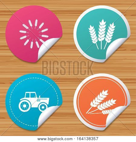Round stickers or website banners. Agricultural icons. Wheat corn or Gluten free signs symbols. Tractor machinery. Circle badges with bended corner. Vector
