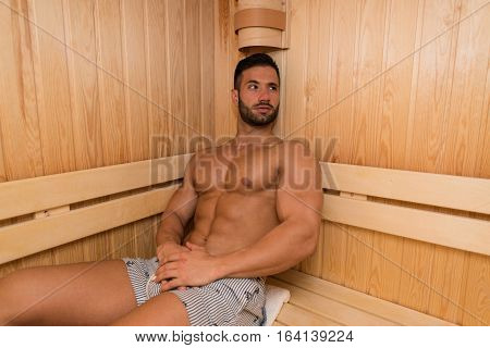 Portrait Of A Muscular Man Relaxing In Sauna