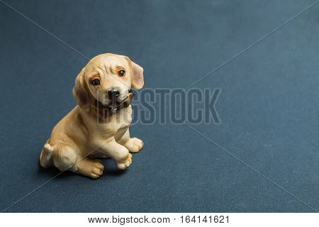 Toy of a dog against a dark background