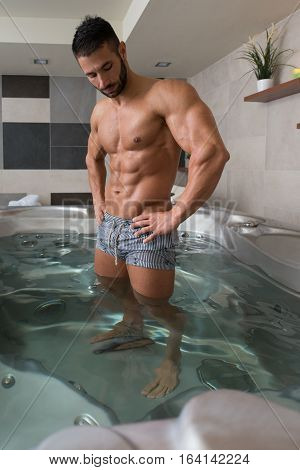 Flexing Muscles In Hot Tube Jacuzzi