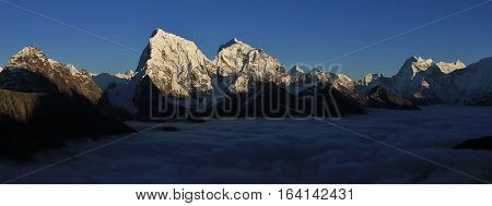 Snow capped mountains Cholatse Taboche and Thamserku. High peaks of the Himalayas.