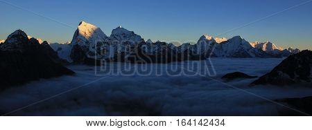 High mountains of the Himalayas at sunset. Mount Cholatse Taboche and Thamserku. Gokyo valley.
