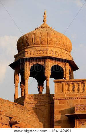 Red stone arched viewing gallery at Gadisar Lake Jaisalmer Rajasthan India Asia