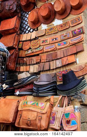 Hats leather purses and bags displayed for sale at Patawon-ki-Haweli Jaisalmer Rajasthan India Asia