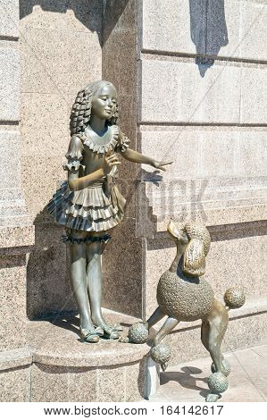 KIEV UKRAINE - May 10.2012: State academic theatre of dolls. Sculptures of fairy-tale personages. Girl Malvina and poodle Artemon