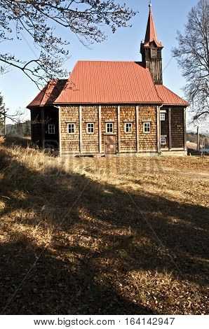 wooden church built in 1890 on Grun with meadow and clear sky in Moravskoslezske Beskydy mountains