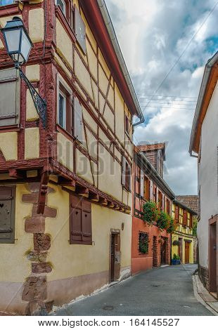 Street with historical houses in Ribeauville Alsace France
