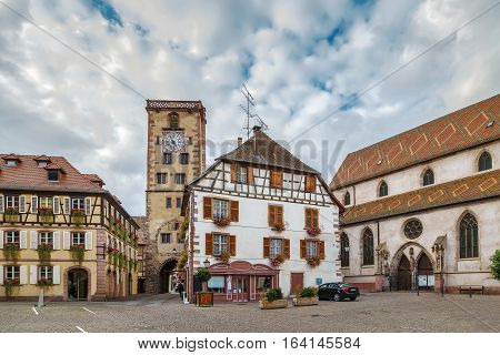 View of square with clock tower in Ribeauville Alsace France