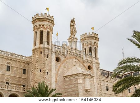 Facade of Notre Dame de Jerusalem with statue of the Virgin Mary with Child Jesus, Notre Dame de France, Catholic monastery and guesthouse in Jerusalem, Israel