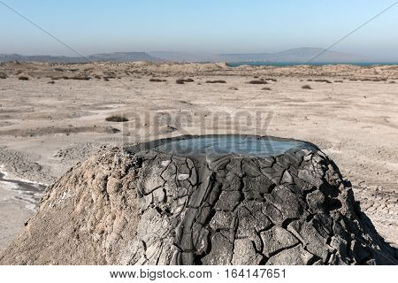 Crater of mud volcano, the bubbling mud