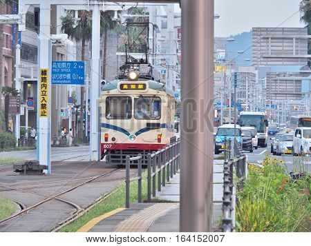 Kochi, Japan - July 19, 2016: The streetcar in Kochi, Japan. The Tosaden Kotsu tram system in Kochi Prefecture, which was inaugurated in 1904, has the longest history of all Japanese tram systems.