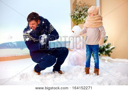 Happy Family Having Fun, Playing In Snowball Fight Outdoor