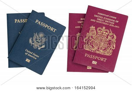 Pair of USA and UK passports isolated against white background