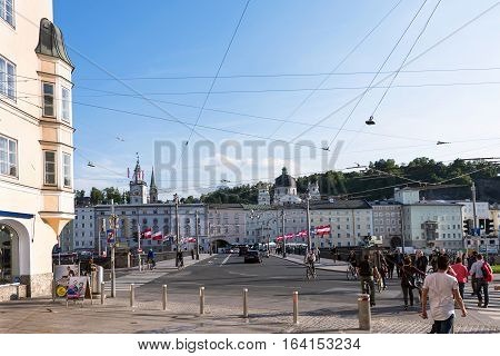 SALZBURG, AUSTRIA - MAY 18, 2016: City street at the bridge with people