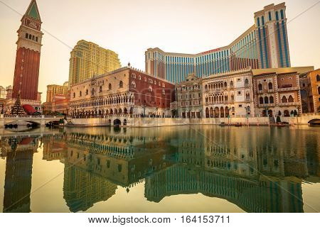 Macau, China - December 9, 2016: the artificial lake in front of The Venetian reflecting at sunset. The Venetian is a luxury hotel, resort, casino and shopping center in Macau twin of Las vegas.