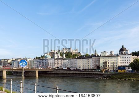 Salzburg skyline with festung hohensalzburg and river salzach salzburger land, bicycle sign, austria
