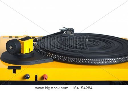 Turntable with black tonearm in yellow case with rubber mat on disc with stroboscope marks with output connectors rear view isolated on white background. Horizontal view closeup
