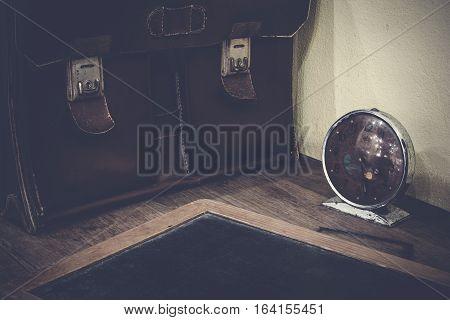 Brown Antique Schoolbag Vintage, Vintage Clock And Antique Slate On Old Wooden Desk. School In The P