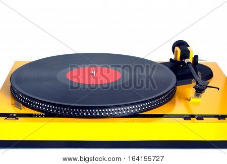 Turntable in gray case with black vinyl record with empty label on disc with stroboscope marks isolated on white background. Horizontal black and white photo front view closeup