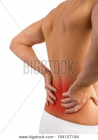 Man having lower back problems an holding his back