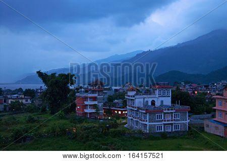 Buildings in the evening near Phewa Lake in Pokhara, Nepal