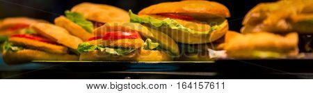 Tray of breaded chicken sandwich with tomatoes