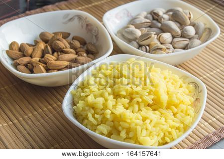 Traditional Indian Pongal, Makar Sankranti rice nuts almonds.