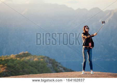 Joyful Woman Travel And Photo Selfie